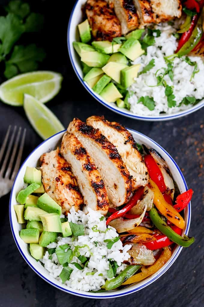 Juicy griddled Cajun chicken with charred veggies and coriander-lime rice – ready in 30 minutes. A great weeknight dinner!